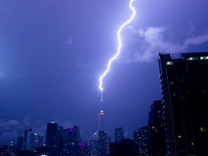 A bolt of lightning strikes the CN Tower during a thunderstorm in Toronto on Wednesday, Aug. 24, 2011. (Photo courtesy of Alice Lipczak).