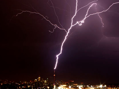 A bolt of lightning strikes the CN Tower during a thunderstorm in Toronto on Wednesday, Aug. 24, 2011. (Photo courtesy of Alice Lipczak). (Photo courtesy of Ian Mationg)