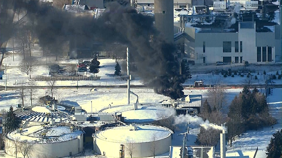 Black smoke billows out of a hole in the roof of a building at a water treatment plant in Pickering on Tuesday, Jan. 21, 2014.