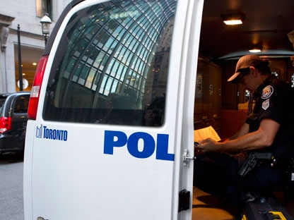 A police officer, from the Forensic Identification Service, sits in his van outside the 1 King West apartment in Toronto after former NHL player Wade Belak was found dead on Wednesday August 31, 2011. Former NHL tough guy Belak has been found dead in Toronto, the third NHL tough guy to die in 2011 and second in less than a month. THE CANADIAN PRESS/Chris Young