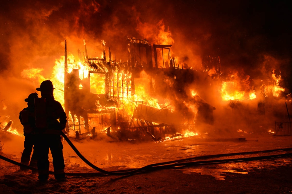 Firefighters try to extinguish a fire at a seniors residence in L'Isle-Verte, Que., early Thursday, Jan. 23, 2014. (Francois Drouin/Info Dimanche)