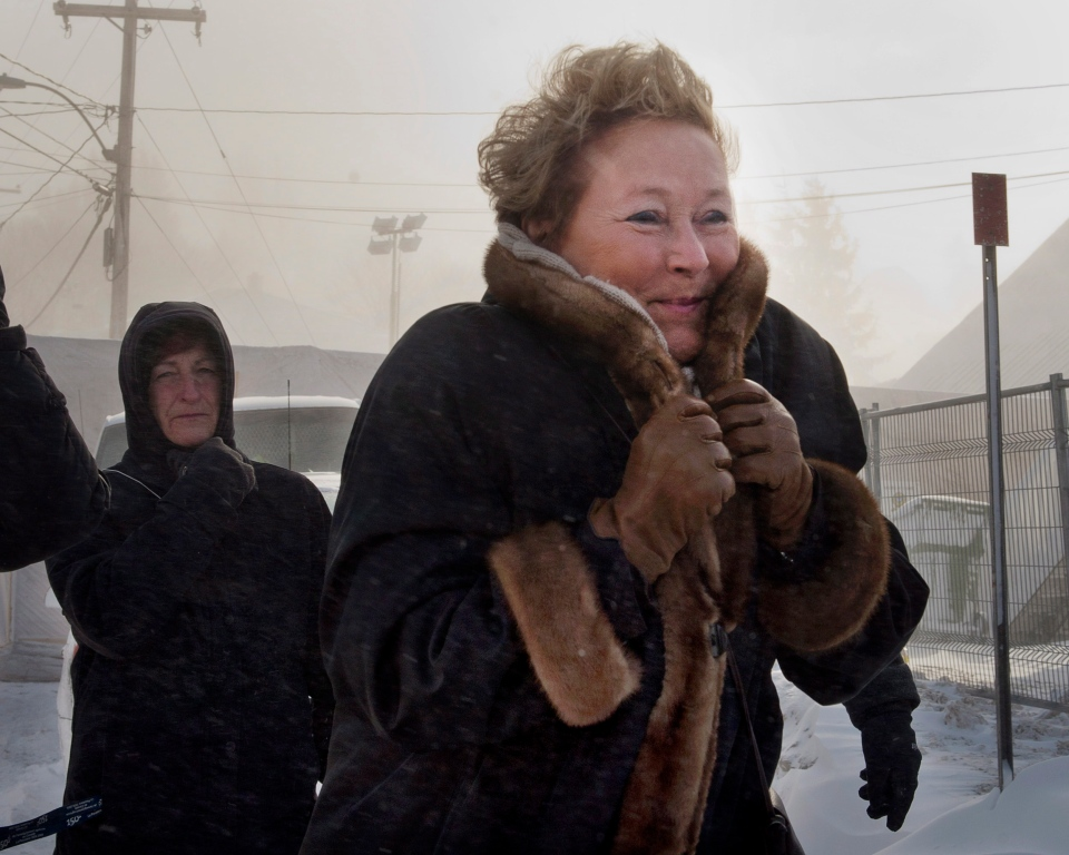 Quebec Premier Pauline Marois visits the site of the fatal fire at a seniors residence, Sunday, January 26, 2014 in L'Isle-Verte, Que. THE CANADIAN PRESS/Ryan Remiorz