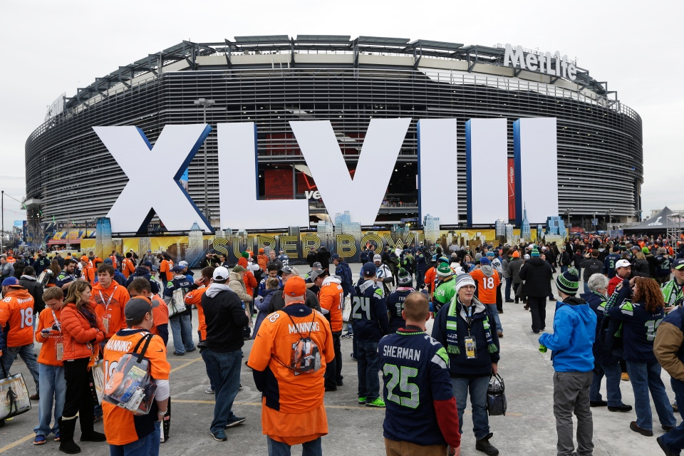 Fans arrive for the NFL Super Bowl XLVIII football game between the Seattle Seahawks and the Denver Broncos at MetLife Stadium Sunday, Feb. 2, 2014, in East Rutherford, N.J. (AP /Seth Wenig)