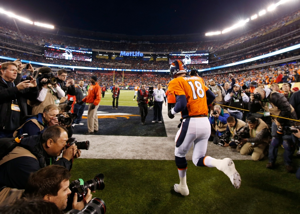 Denver Broncos quarterback Peyton Manning runs onto the field before the NFL Super Bowl XLVIII football game against the Seattle Seahawks Sunday, Feb. 2, 2014, in East Rutherford, N.J. (AP /Evan Vucci)
