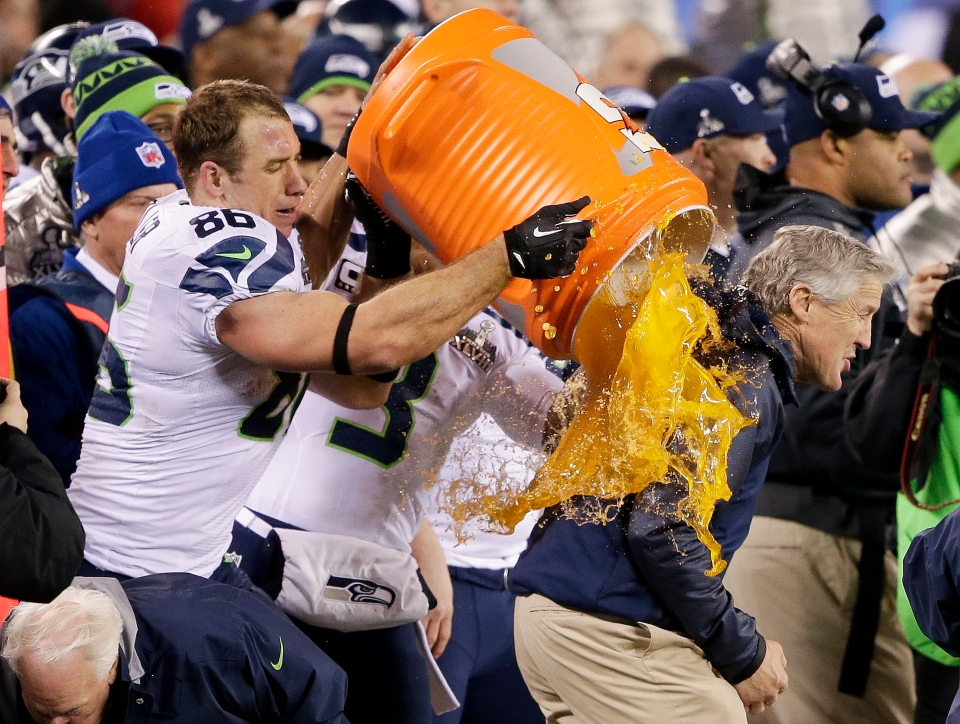 Seattle Seahawks' Zach Miller dumps Gatorade on Seattle Seahawks head coach Pete Carroll during the second half of the NFL Super Bowl XLVIII football game Sunday, Feb. 2, 2014, in East Rutherford, N.J. The Seahawks won 43-8. (AP /Gregory Bull)