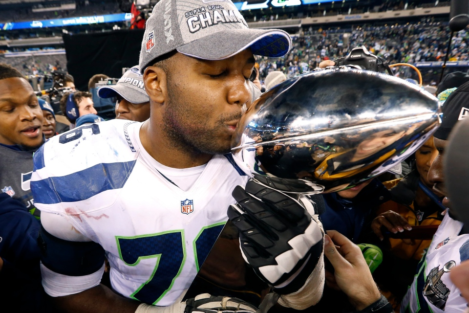Seattle Seahawks' Russell Okung kisses the Lombardi Trophy after the Seahawks won Super Bowl XLVIII Sunday, Feb. 2, 2014, in East Rutherford, N.J. (AP Photo/Paul Sancya)
