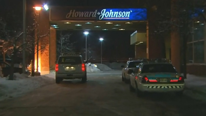 Toronto police investigate an incident at a Howard Johnson hotel in Scarborough late Monday, Feb. 3, 2014.