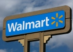 A Walmart sign is pictured in this file photo. (AP Photo/Damian Dovarganes)
