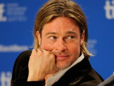 """Actor Brad Pitt participates in a news conference for the film """"Moneyball"""" during the Toronto International Film Festival on Friday, Sept. 9, 2011, in Toronto. (AP Photo/Evan Agostini)"""