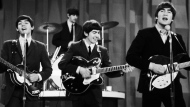 """In this Feb. 9, 1964 file photo, The Beatles , from left, Paul McCartney, Ringo Starr on drums, George Harrison and John Lennon, perform on the CBS """"Ed Sullivan Show"""" in New York. (AP Photo/Dan Grossi/ File)"""