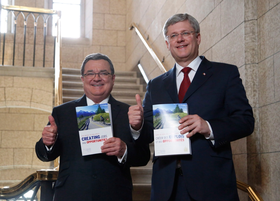 Minister of Finance Jim Flaherty and Prime Minister Stephen Harper enter the House of Commons on budget day on Parliament Hill in Ottawa on Tuesday, Feb. 11, 2014. (The Canadian Press/Patrick Doyle)