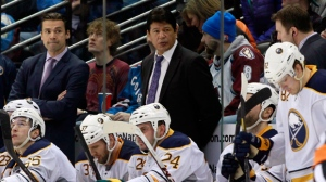 Buffalo Sabres interim head coach Ted Nolan looks on as his team falls behind the Colorado Avalanche in the third period in Denver, Saturday, Feb. 1, 2014. (AP Photo/David Zalubowski)