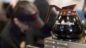 Freshly-brewed coffee sits on a hot plate in a Tim Hortons outlet in Oakville, Ont. on Sept.16, 2013. (The Canadian Press/Chris Young)