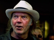 "Neil Young talks with people as he arrives for new movie ""Neil Young Journeys"" at the Toronto International Film Festival in Toronto on Monday, Sept., 12, 2011. (THE CANADIAN PRESS/Nathan Denette)"