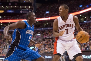 Toronto Raptors' Kyle Lowry (right) looks to play a pass beyond Orlando Magic's Victor Oladipo during second half NBA basketball action in Toronto on Sunday February 23, 2014. (Chris Young/The Canadian Press)