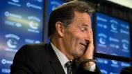 Vancouver Canucks' head coach John Tortorella laughs and rubs his face in response to a question during a news conference after he was hired by the NHL hockey team in Vancouver, B.C., on Tuesday June 25, 2013. (The Canadian Press/Darryl Dyck)