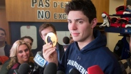Montreal Canadiens and Team Canada goaltender Carey Price shows his gold medal to the media at the team's practice facility Monday, Feb. 24, 2014 in Brossard, Que. (The Canadian Press/Ryan Remiorz)