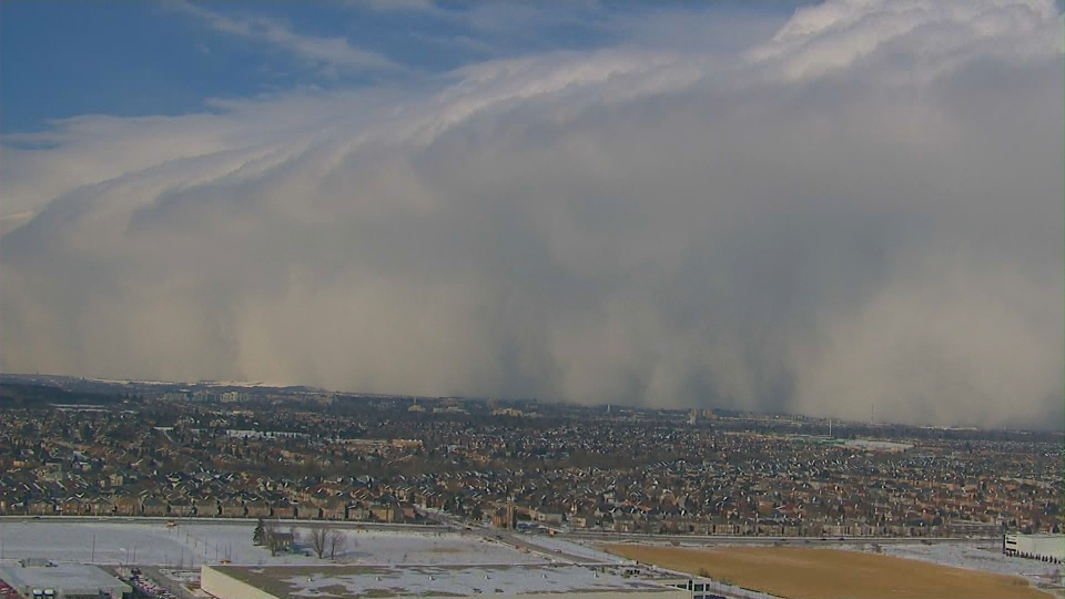 A snow squall moves north of Toronto on Thursday, Feb. 27, 2014.