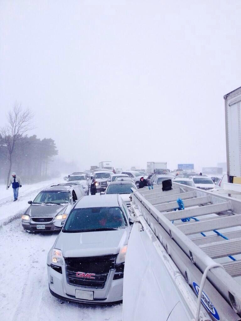 Several vehicles were involved in a pileup in Highway 400's southbound lanes near Innisfil Beach Road on Thursday, Feb. 27, 2014. (@GlitterCheryl/Twitter)