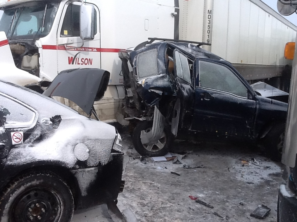 Dozens of vehicles were involved in a pileup in Highway 400's southbound lanes, south of Barrie, on Thursday, Feb. 27, 2014. (Sgt. Dave Woodford/OPP)