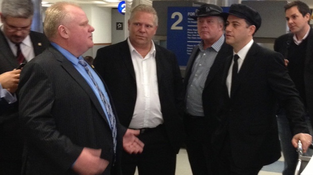Mayor Rob Ford and his brothers are greeted by comedian Jimmy Kimmel after touching down in Los Angeles Saturday, March 1, 2014 (Jennifer Morrison/eTalk)