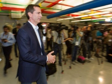 Ontario Liberal leader Dalton McGuinty arrives to answer questions during a campaign event on Monday September 12, 2011 at Electrovaya in Mississauga, Ontario. THE CANADIAN PRESS/Frank Gunn