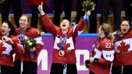This Feb. 20, 2014 file photo shows members of Team Canada celebrating after defeating the United States during sudden death overtime women's hockey final action at the 2014 Sochi Winter Olympics in Sochi, Russia. (The Canadian Press, Nathan Denette)