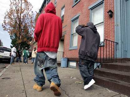 Two young men with low-slung, baggy jeans walk in Trenton, N.J., Saturday, Sept. 15, 2007. (AP Photo/Mel Evans)