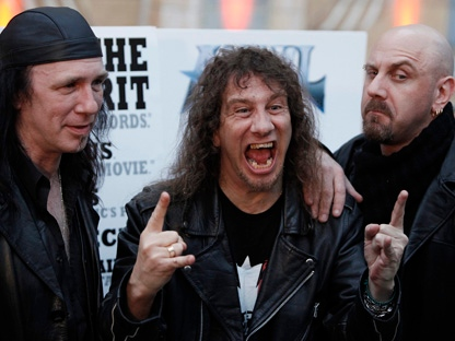 """Steve Kudlow, centre, Robb Reiner, left, and Glenn Five, of the Canadian band Anvil, arrive at the premiere of """"Anvil! The Story of Anvil"""" in Los Angeles on Tuesday, April 7, 2009. (AP Photo/Matt Sayles)"""