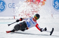 Josh Dueck of Canada races to win his silver medal in downhill, sitting skiing event at the 2014 Winter Paralympic, Saturday, March 8, 2014, in Krasnaya Polyana, Russia. (AP Photo/Dmitry Lovetsky)