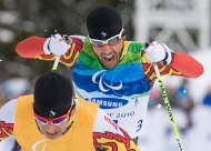 In this Monday, March 15, 2010, file photo, Brian McKeever races to a gold medal win in the men's 20-kilometre free, visually impaired cross-country ski race at the 2010 Winter Paralympic Games in Whistler. (The Canadian Press/Jonathan Hayward)