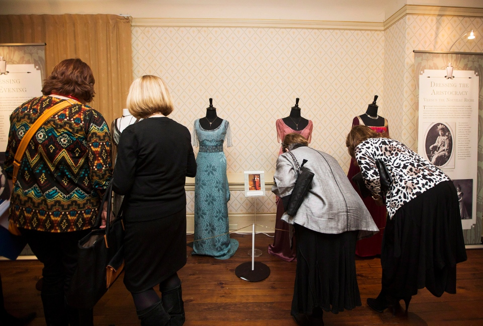 "People attend a media preview for the Canadian launch of the ""Dressing for Downton: Costumes from Downton Abbey"" exhibit at the Toronto Spadina Museum on Friday, March 7, 2014. (The Canadian Press/Michelle Siu)"
