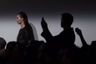 A model stands to the side as a creation from Mikhael Kale is shown on the runway during Toronto Fashion Week in Toronto on Monday March 17, 2014. (Chris Young / THE CANADIAN PRESS)