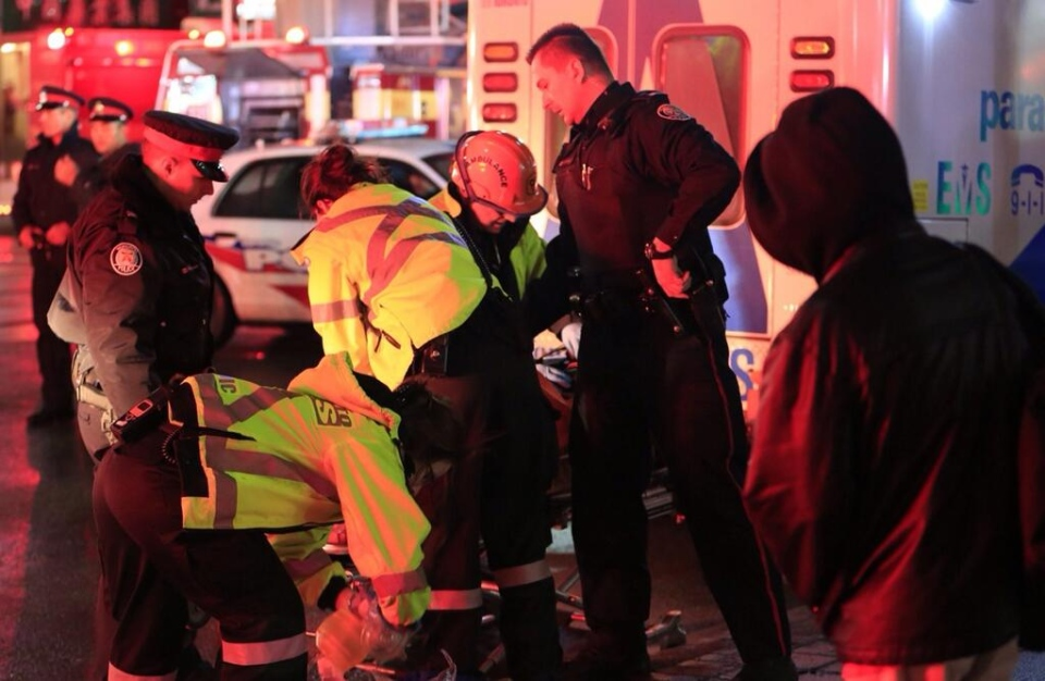 Paramedics perform CPR on a person who was pulled from a rooming house on St. Andrew Street in Kensington Market early Thursday, March 20, 2014. (Tom Stefanac/CP24)