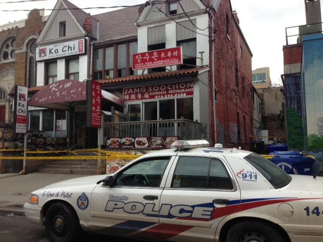 Two men were killed in a fire on St. Andrew Street in Kensington Market on Thursday, March 20, 2014. (Cam Woolley/CP24)