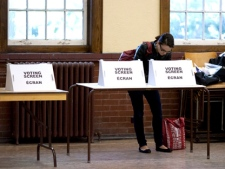 A woman casts her ballot at a voting station in Toronto during the Ontario provincial election Thursday, Oct. 6, 2011. THE CANADIAN PRESS/Chris Young.