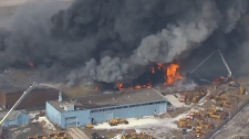 Firefighters battle inferno at factory