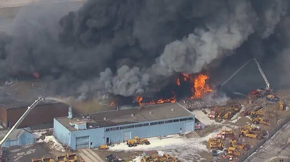 Firefighters battle a massive blaze at an industrial building near Dufferin Street and Eglinton Avenue West on Thursday, March 27, 2014.