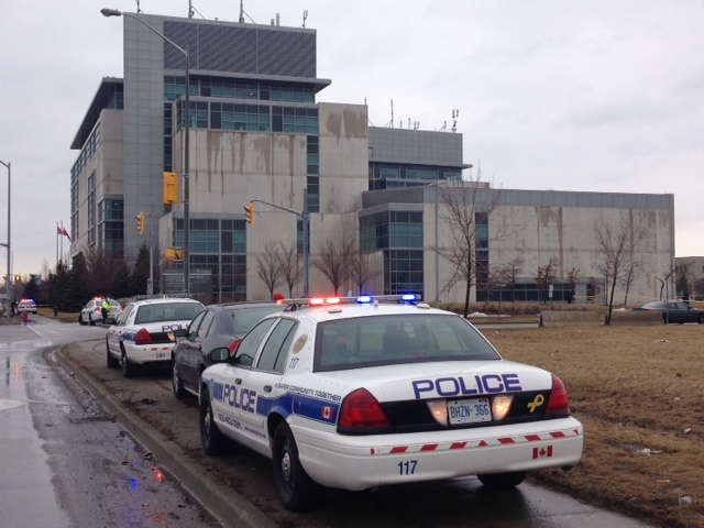 Police vehicles are pictured outside a Brampton courthouse where one person was shot Friday, March 28, 2014. (Cam Woolley/CP24)