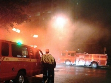 A fire official stands at the scene of an apartment fire on Weston Road early Thursday, Oct. 13, 2011. (CP24/Tom Stefanac)