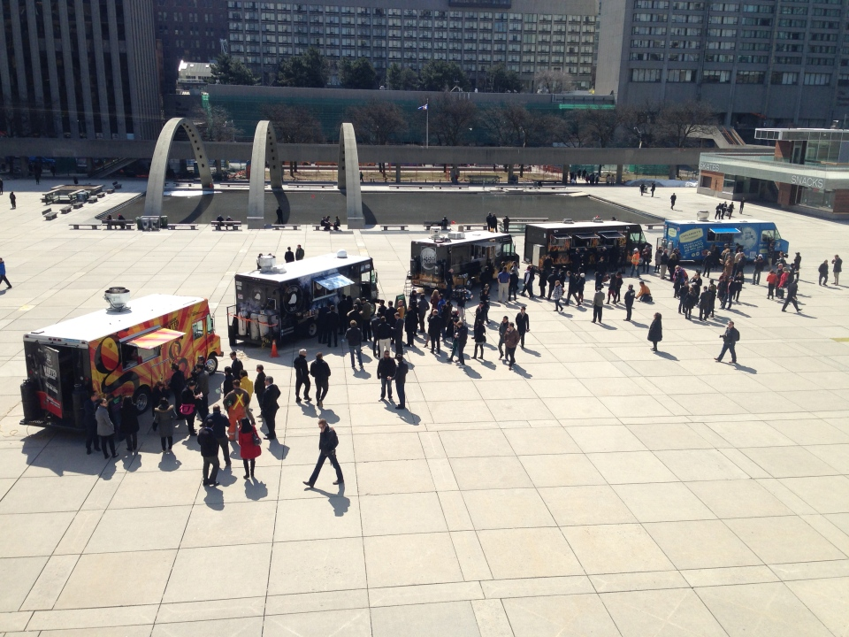 Food trucks serve customers at a rally in Nathan Phillips Square on Wednesday, April 2, 2014. (Chris Kitching/CP24)