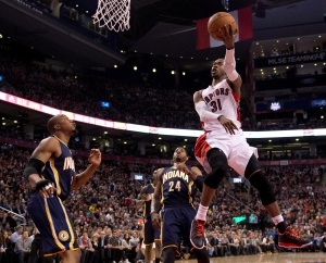 Toronto Raptors guard Terrence Ross (31) soars through the air past Indiana Pacers forwards David West (left) and Paul George (24) during first half NBA action in Toronto on Friday, April 4, 2014. (The Canadian Press/Frank Gunn)
