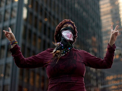 A protester stands outside the Toronto Stock Exchange in the city's financial district on Monday, Oct. 17, 2011, as part of an Occupy Bay Street protest. The protest was organized by an Occupy Toronto splinter group. (THE CANADIAN PRESS/Chris Young)