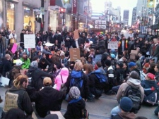 Protesters stage a sit in at Yonge-Dundas Square as part of the Occupy Toronto movement on Monday, Oct. 17, 2011.