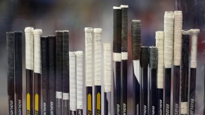 Hockey sticks are seen in this file photo. (AP Photo/Mark Humphrey)