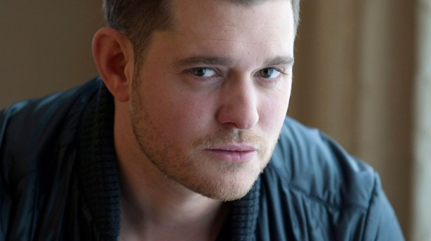 Michael Buble poses for photos during an interview in Toronto on Tuesday, Oct. 11, 2011. (Frank Gunn / THE CANADIAN PRESS)