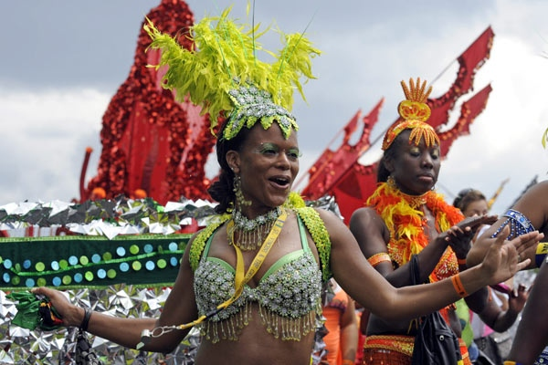 Revelers dance on Lakeshore Boulevard during the Caribana Parade in Toronto on Saturday, Aug. 2, 2008. (Aaron Harris  / THE CANADIAN PRESS)
