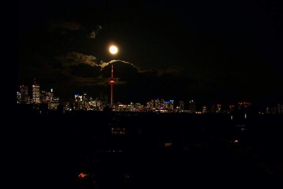 A large portion of the city can be seen without power in this photo taken on Tuesday, April 15, 2014. (Twitter/@GregTdot)