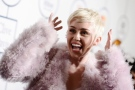 In this Jan. 25, 2014 file photo, Miley Cyrus arrives at the 56th annual Grammy awards in Beverly Hills, Calif. (Photo by Dan Steinberg/Invision/AP)