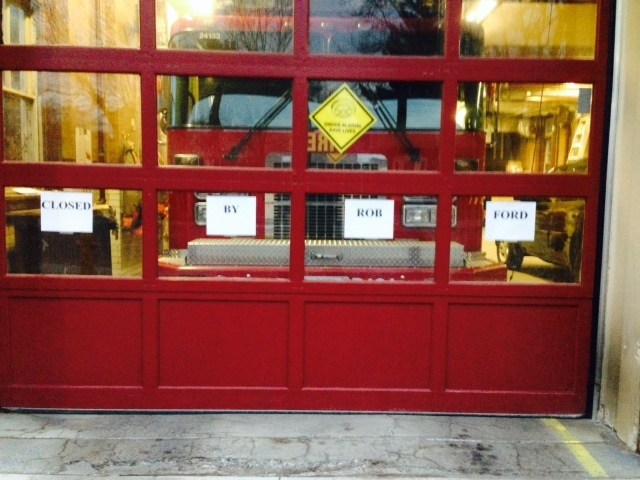 "Signs reading ""Closed by Rob Ford"" are posted on a door at Fire Station 424 on Runnymede Road in Toronto on Monday, April 21, 2014. One of four pumper trucks being taken out of service was based at the west-end fire hall. (Cam Woolley/CP24)"